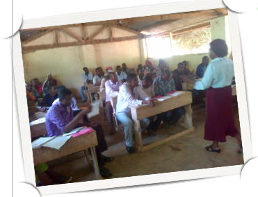 Dr Josephine Gitombe speaking to students at Dadaab University campus of Kenyatta University, global education magazine