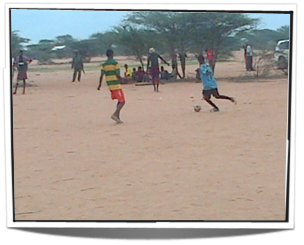 Refugee playing football at Dagahaley camp, global education magazine